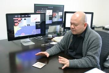 マーカーとヘッドマウント型ディスプレイを使うことで、机上で津波の危険度を共有できる